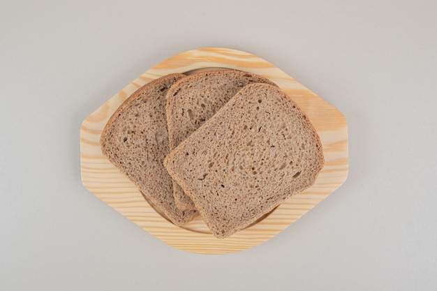 Sliced fresh brown bread on white background. high quality photo