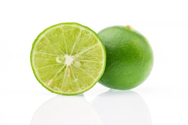 Sliced fresh lime fruit on white background