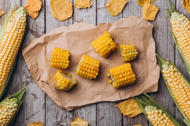 Sliced grilled corn on rustic background