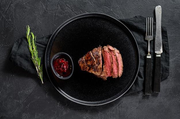 Sliced grilled filet mignon steak. beef tenderloin.
