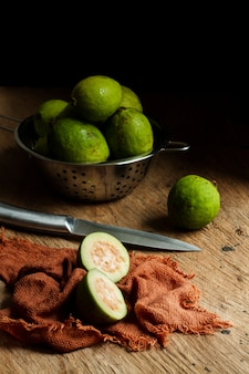 Sliced guava fruit on wooden table