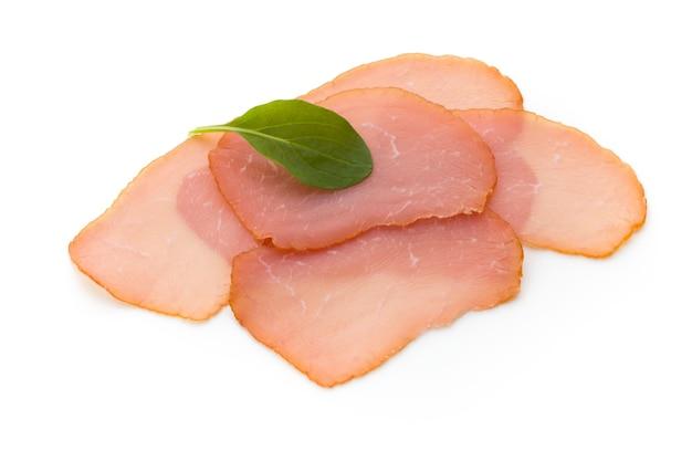 Sliced ham on white background.fresh prosciutto.pork ham sliced on white background.