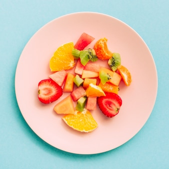 Sliced juicy refreshing exotic fruits on plate