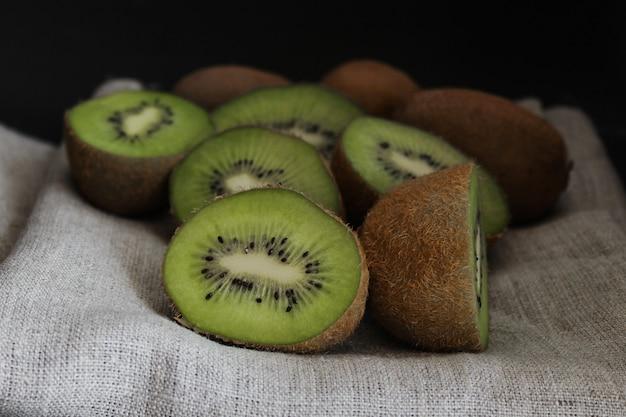Sliced kiwi close up. green fruit, dark background