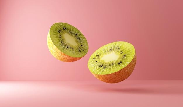 Sliced kiwi fruit pieces on blue studio background