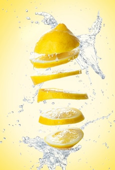 Sliced lemon on yellow wall