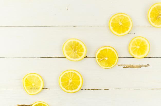 Sliced lemons scattered on table