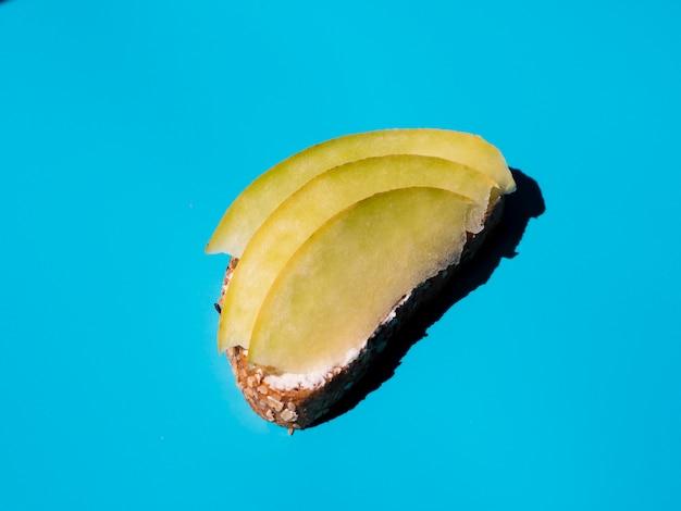 Sliced mango on a veggie sandwich