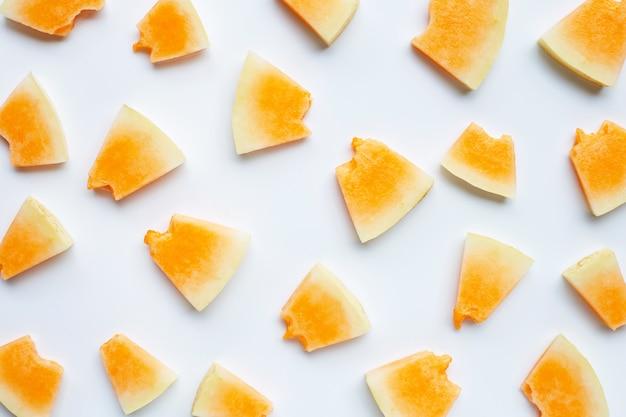 Sliced melon on white background.