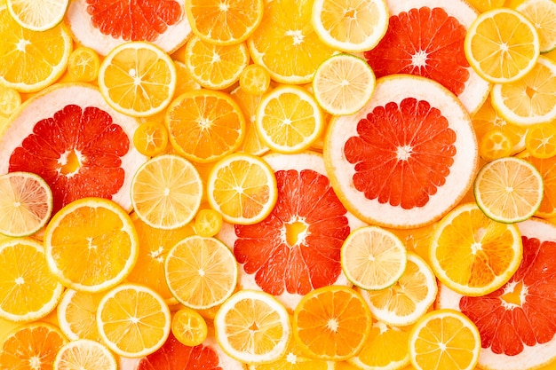 Sliced mixed citrus fruits, concept of healthy eating, detox, dieting, top view and flatlay.