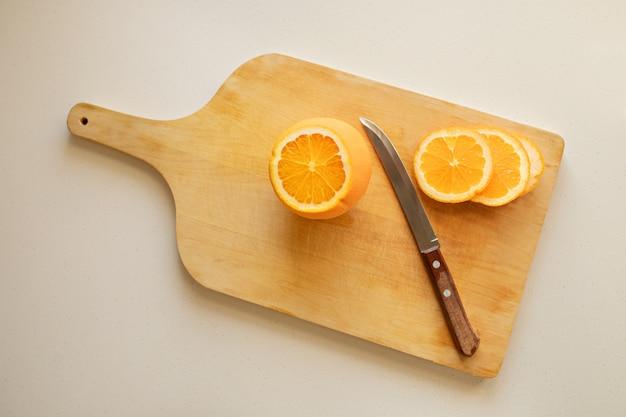 Sliced orange on cutting board