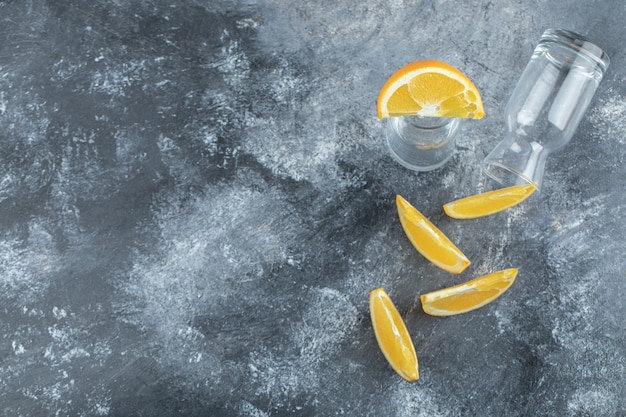 Sliced orange and empty on marble table.