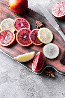 Sliced orange slices and lime on a wooden dovetail