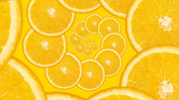 Нарезанный апельсин, спиральный узор. фрактальный фон свежие сочные фрукты. яркий плоский фон.