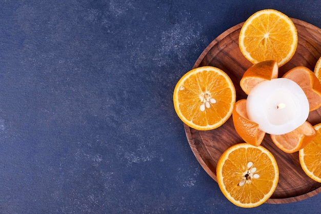 Sliced oranges isolated on a wooden platter. high quality photo