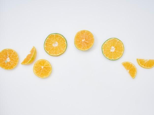 Sliced oranges on a white background