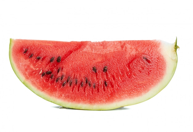 Sliced piece of ripe juicy watermelon with brown seeds isolated on white background, summer berry