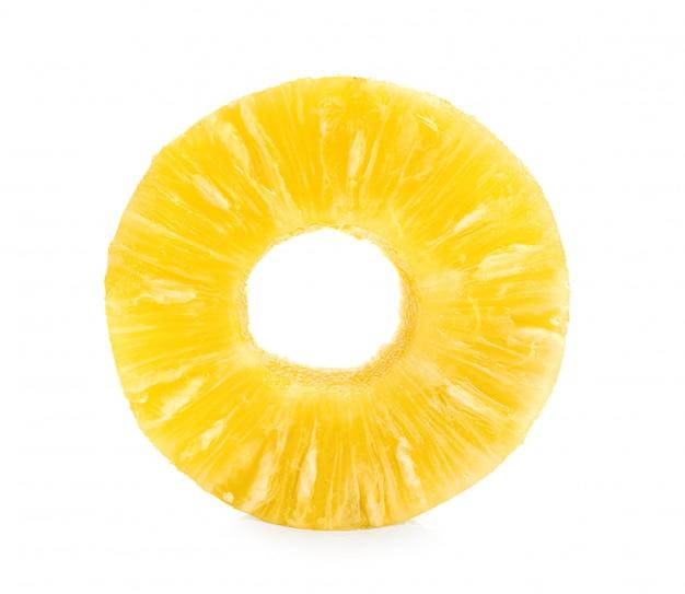 Sliced pineapple over white wall.