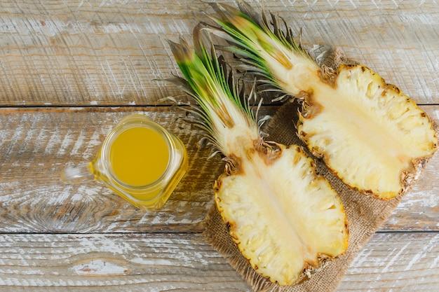 Sliced pineapple with juice on sackcloth