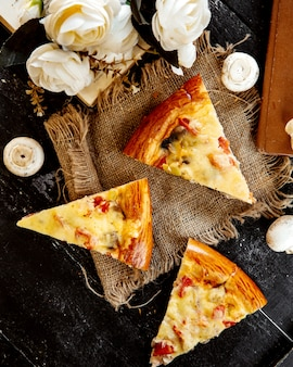 Sliced pizza with mushrooms and cheese