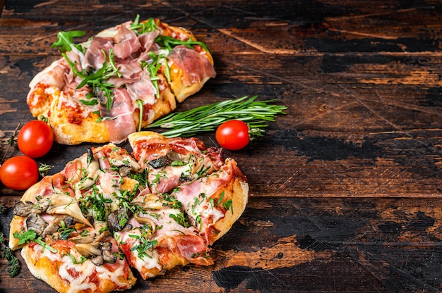 Sliced pizza with prosciutto parma ham, arugula and parmesan cheese