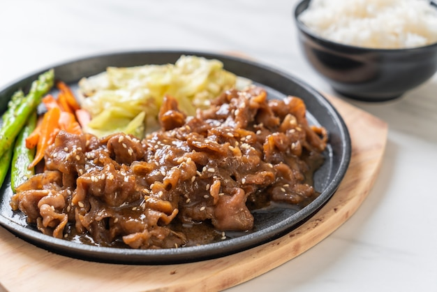 Sliced pork steak on hot plate