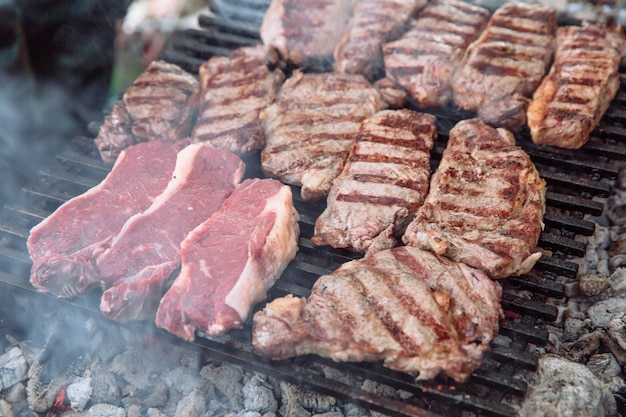 Sliced portions of hot and juicy steak  on the grill