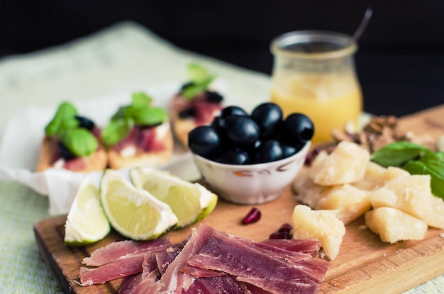 Sliced prosciutto with appetizers