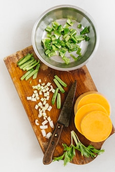 Sliced pumpkin and celery on chopping board