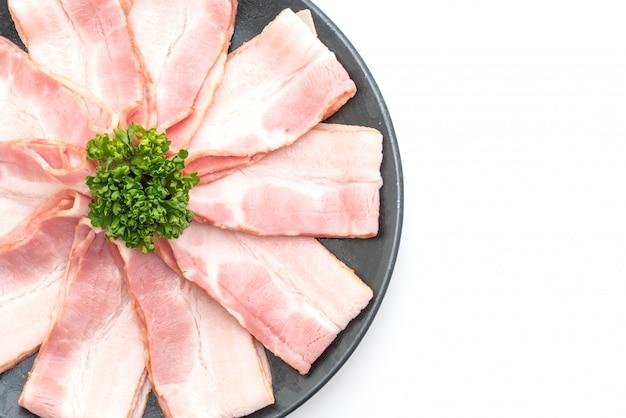 Sliced raw pork bacon