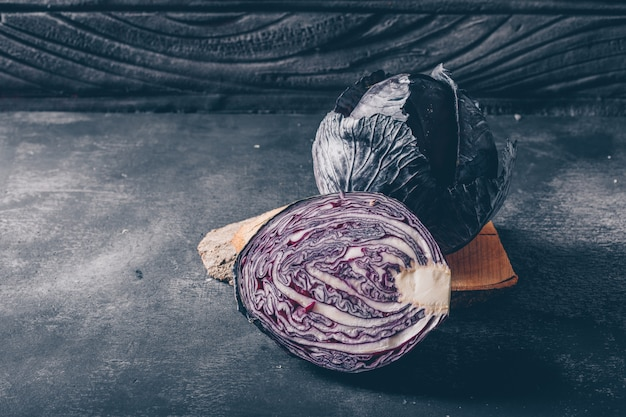 Sliced red cabbage on a dark textured background. high angle view.