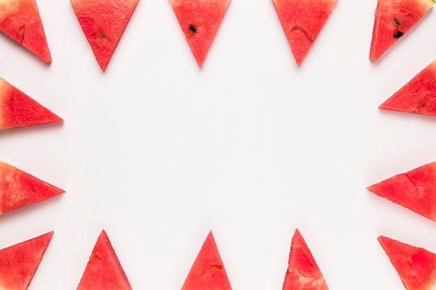 Sliced red watermelon on white surface