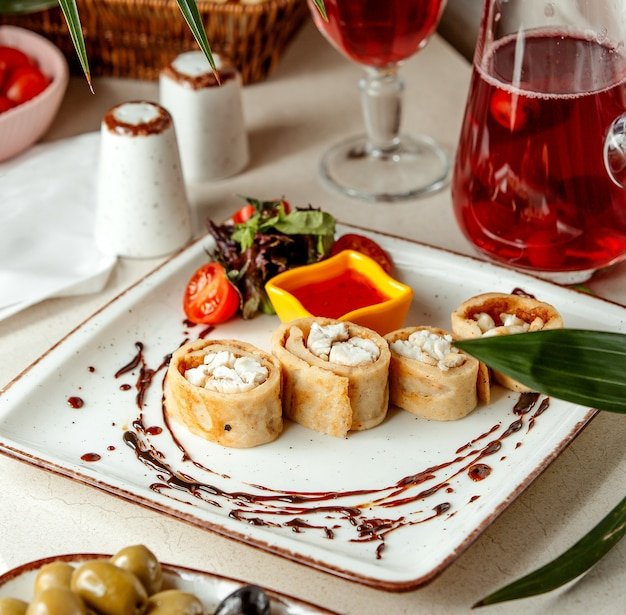 Sliced rolls with fish and sweet chili with compote