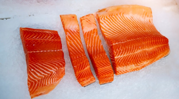 Sliced salmon lying on the ice in the refrigerator store