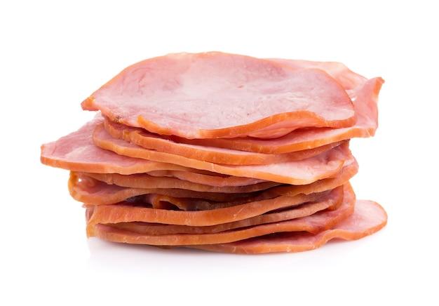 Sliced smoked ham isolated on white surface
