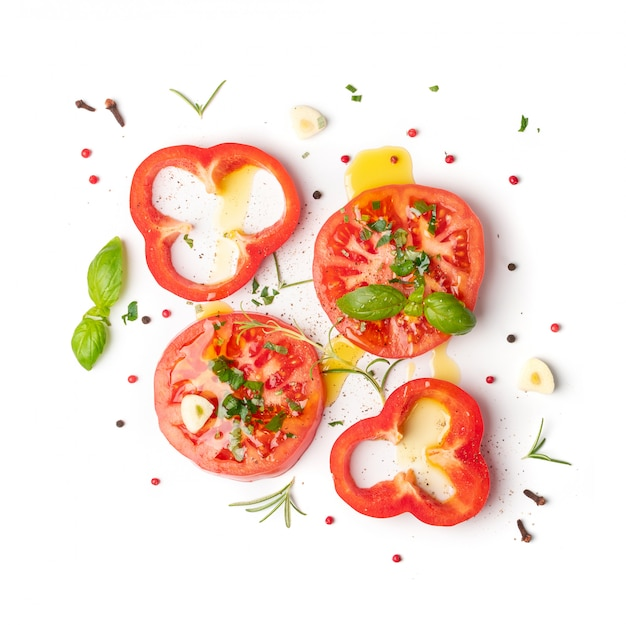 Sliced tomatoes and basil top view and flat lay