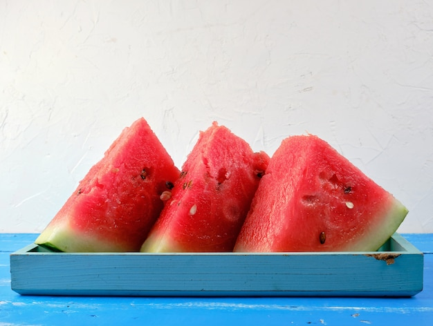 Sliced triangles ripe red round watermelon with seeds