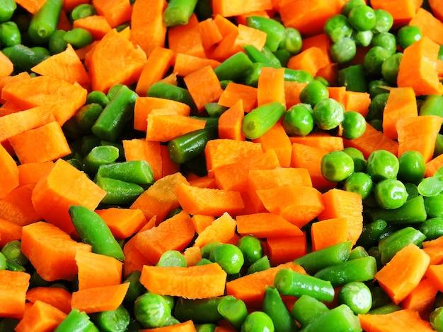 Sliced vegetables before baking on the pan for baking.