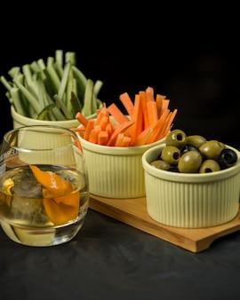 Sliced vegetables set on wooden board