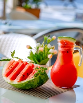 Sliced watermelon and jar with watermelon juice