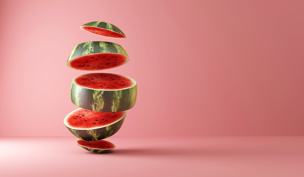 Sliced watermelon pieces on pink studio background
