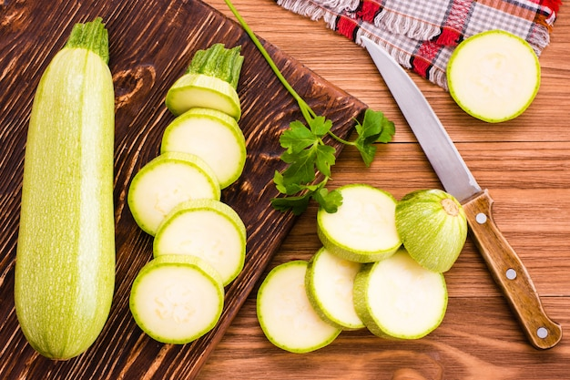 Sliced zucchini on wooden table,, top view