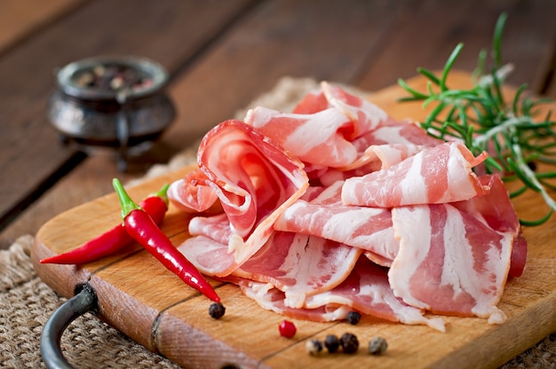 Slices of bacon with herbs and spices