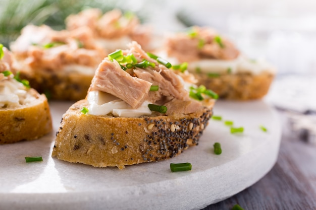 Slices of baguette with fresh tuna