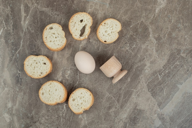 Slices of bread and egg on marble background. high quality photo
