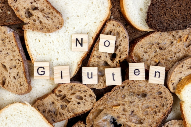 Slices of bread and no gluten sign text close-up
