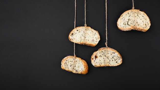 Slices of bread tied with rope