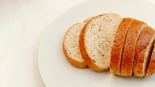 Slices of bread on white plate