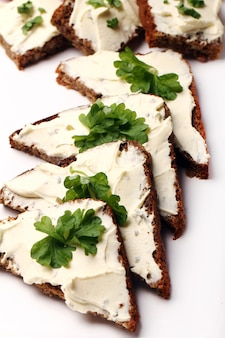 Slices of bread with cream cheese