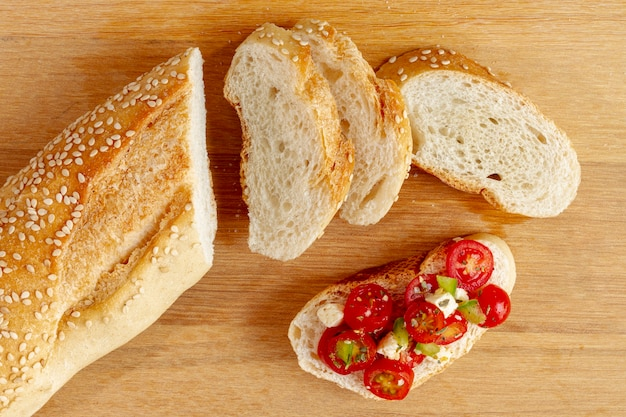 Slices of bread with cut tomatoes